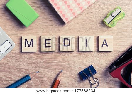 Concept of media and social communication on wooden table