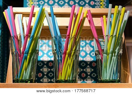 colorful swizzle sticks in a glass container