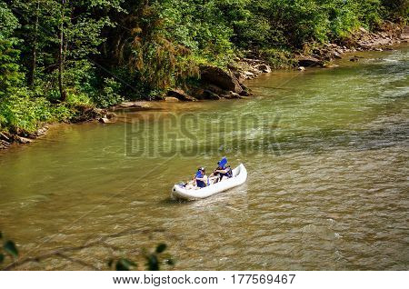 two people drifting boat swift mountain river. extreme sports