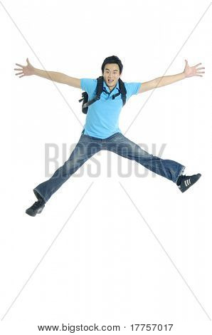 Excited Young man jumping in mid-air cheering and celebrating his success