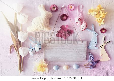 Sign With Copy Space For Advertisement. Sunny Retro Flat Lay With Easter Decoration Like Bunny And Eggs. Spring Flowers On Pink Wooden Background