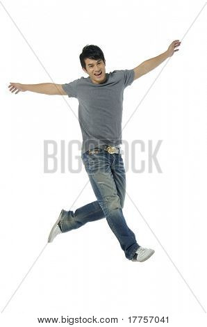 Young man jumping of joy on white background