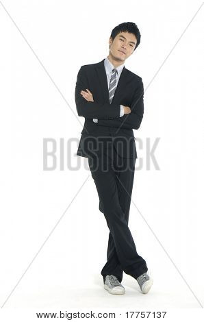 Portrait of a young businessman standing comfortably.