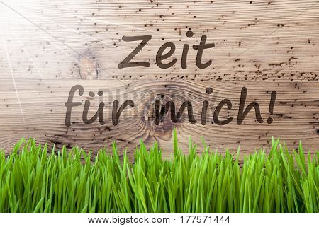 German Text Zeit Fuer Mich Means Time For Me. Spring Season Greeting Card. Bright, Sunny And Aged Wooden Background With Gras.