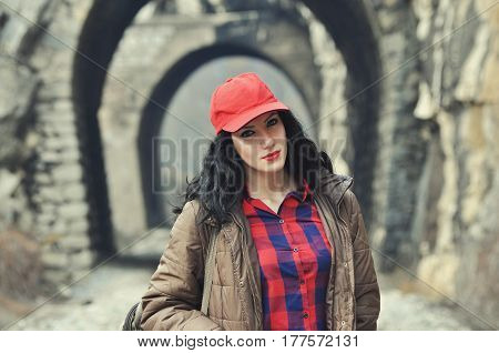 Teenage girl on railway line in front of tunnel. Portrait of beautiful girl in front of the railway tunnel