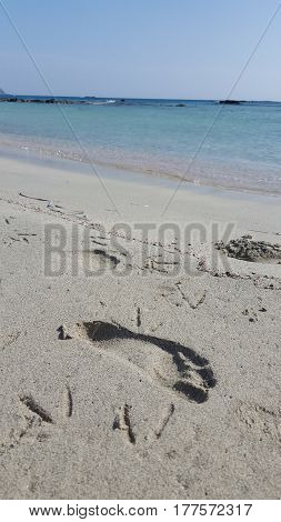 Footprint at a beach with pink sand