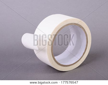 Roll of paper adhesive tape on gray background