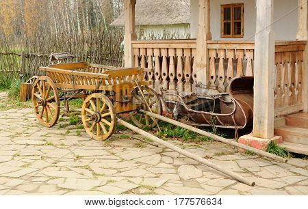 Cart and aged sledge about a porch