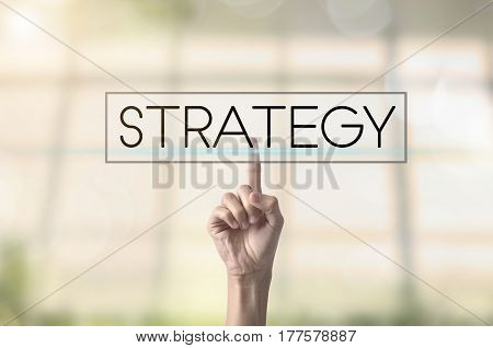 Businessman hand pressing button strategy. sign on virtual screen. can used for cover page presentation and web banner.