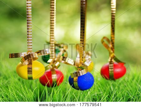 Easter Eggs Hanging On Golden Ribbons