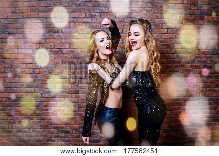 Modern girls having fun on a night party. Celebration. Christmas party.
