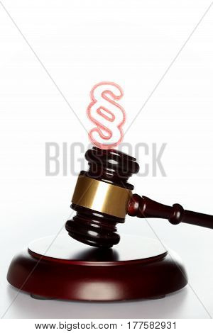 gavel with red paragraph symbol on white background