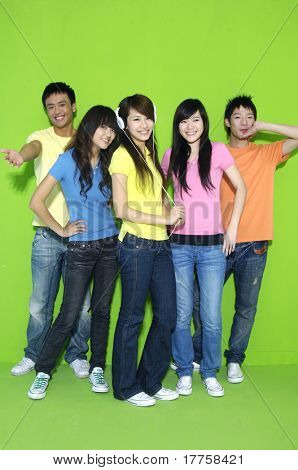 Group of college students on green background