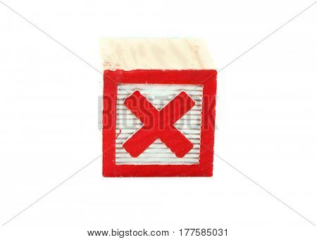 Red cross on a wooden block