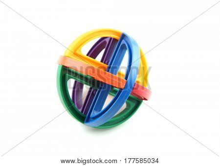 Circular colorful plastic puzzle on white background