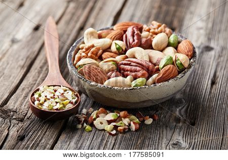 Mix nuts on a wooden background. Cut nuts