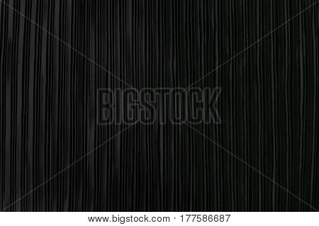 Black pleated fabric. Plisse fabric background texture.