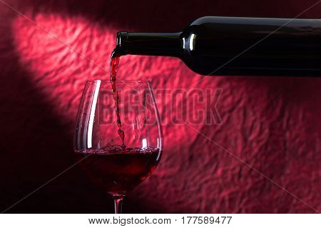 Bottle And Glass Of Red Wine On A Dark  Background