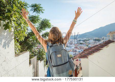 Girl tourist enjoying the old Mediterranean town.