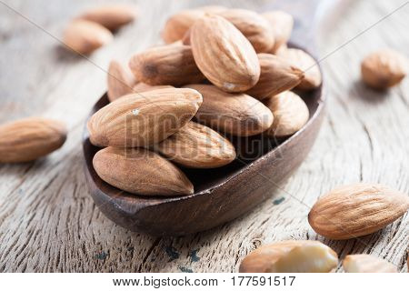 almond on the wooden background .. .