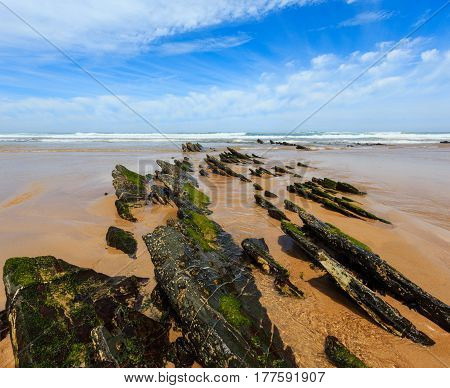 Rock Formations On Sandy Beach (portugal).