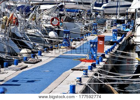 Energy support equipment for nautical vessels in the marina with moorings and yachts