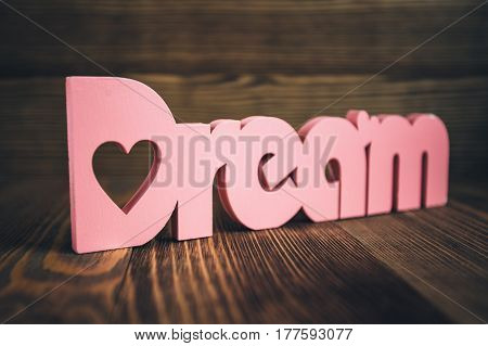 Dreams wooden letters on a wooden background