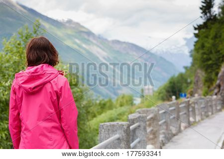 Tourism vacation and travel. Tourist woman enjoying mountains landscape at summer in Norway Scandinavia.