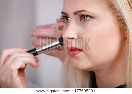 Woman Getting Her Makeup Done With Professional Brush