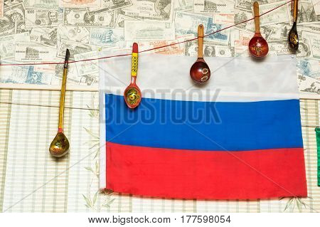 Closeup picture of Russian flag and Khokhloma spoons hanging on a wall