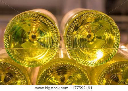 Close up of white wine bottles'bottoms in supermarket