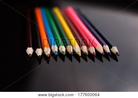 A colored pencils on a black table
