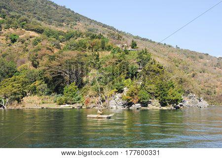 San Pedro la Laguna Guatemala - 10 February 2014: Mayan indigenous fishing on his canoe at San Pedro on lake Atitlan Guatemala