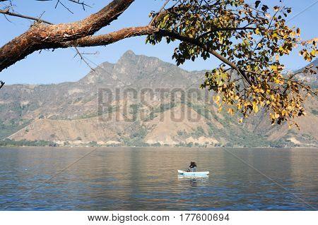 Mayan Indigenous Fishing On His Canoe At San Pedro On Lake Atitlan, Guatemala