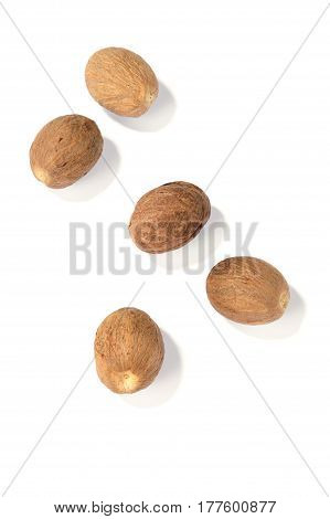 some nutmegs isolated on a white background