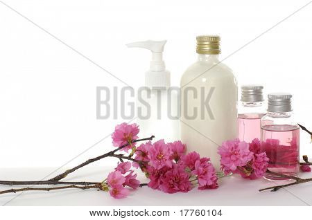 bottle of body lotion with red flower