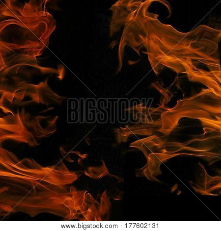 Fires on both sides of black background. Between two fires isolated on black with empty place for your design.