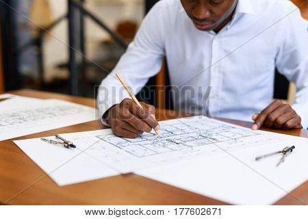 Civil engineer drawing sketch of new construction project