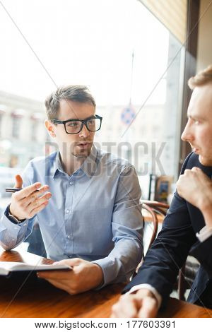 Confident trader negotiating with colleague or explaining his point of view