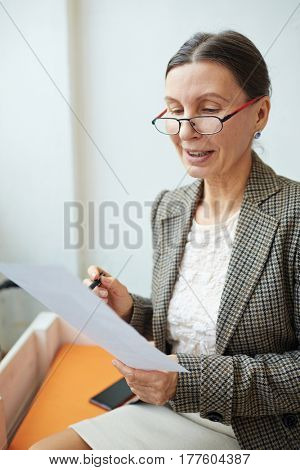 Teacher reading written task of a student