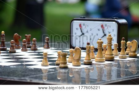 Chessboard with white and black chess pieces