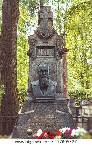 ST.PETERSBURG RUSSIA - AUGUST 04 2013: Necropolis of Alexander Nevsky Lavra. Monument to Russian writer a classic of Russian and world literature Fyodor Dostoevsky