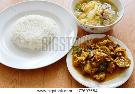 rice eat with spicy stir fried wild boar curry and egg soup
