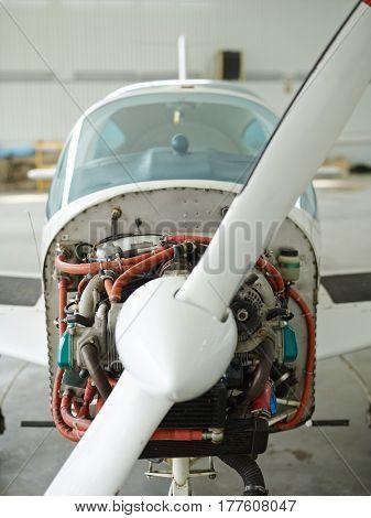 Jetliner with rotating turbine in hangar
