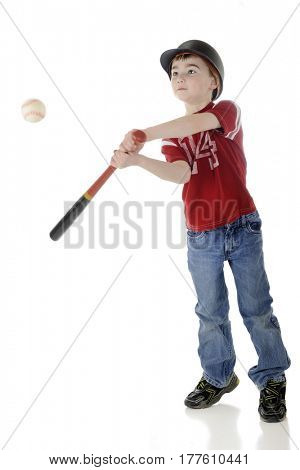 A young elementary baseball batter hitting the ball.  Motion blur on bat and ball.  On a white background.