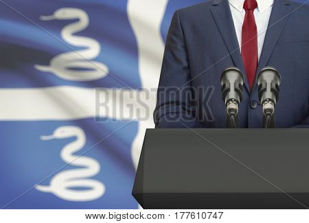 Businessman Or Politician Making Speech From Behind A Pulpit With National Flag On Background - Mart