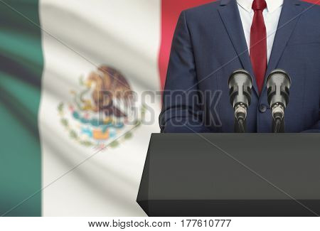Businessman Or Politician Making Speech From Behind A Pulpit With National Flag On Background - Mexi