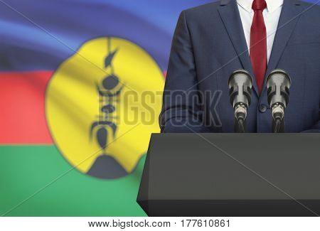 Businessman Or Politician Making Speech From Behind A Pulpit With National Flag On Background - New