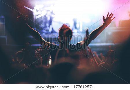 Rear View Of A Man Enjoying A Concert