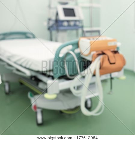 Empty hospital ward with equipment unfocused background.